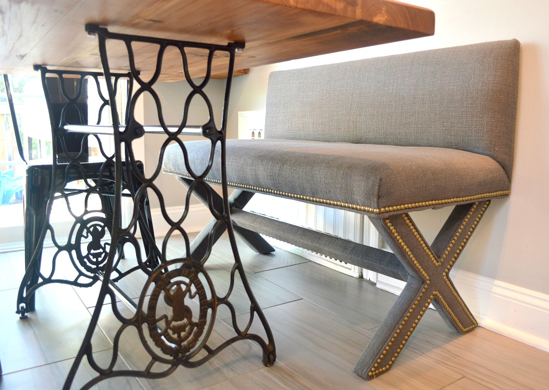 sensing serendipity upcycled antique singer sewing machine the tori double x bench from ballard designs is covered in trilby basketweave charcol fabric and brass nail heads i sprayed scotch guard on the bench as a