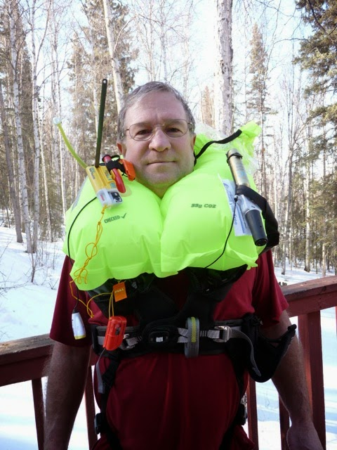 Bill demonstrating inflatable PFD