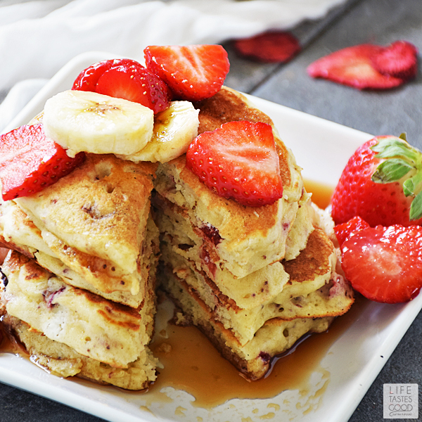 Strawberry Pancakes loaded with delicious dried strawberries and drizzled in maple syrup