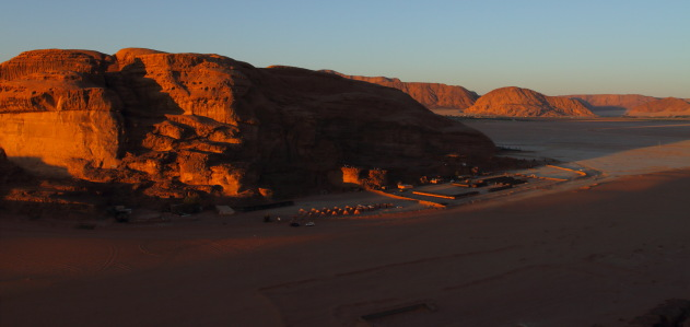 Setting sun casts a golden glow on the desert camps of Wadi Rum, Jordan
