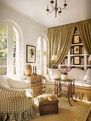 French country interior with checked fabric slipcovers and trunk baskets. Pamela Pierce.