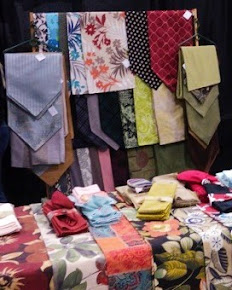 Seasons & Occasions offer a wide selection of table linens, purses, totes, blankets and stuffies.