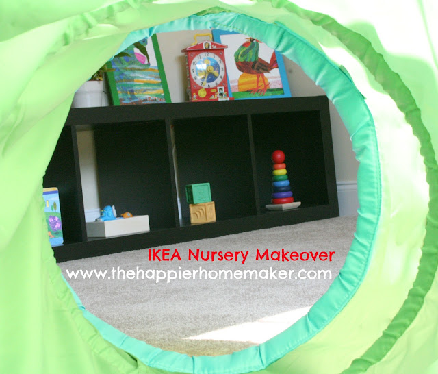 A picture through a play tunnel looking at a small bookcase