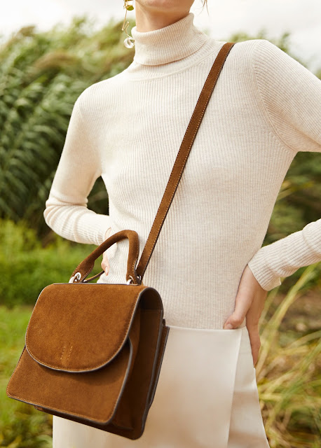 tan bag with winter whitte