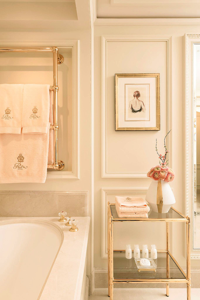 Luxurious bathroom decor inspiration! Pale pink, gold hardware, and paneled walls in a bathroom at Ritz Paris. Romantique!