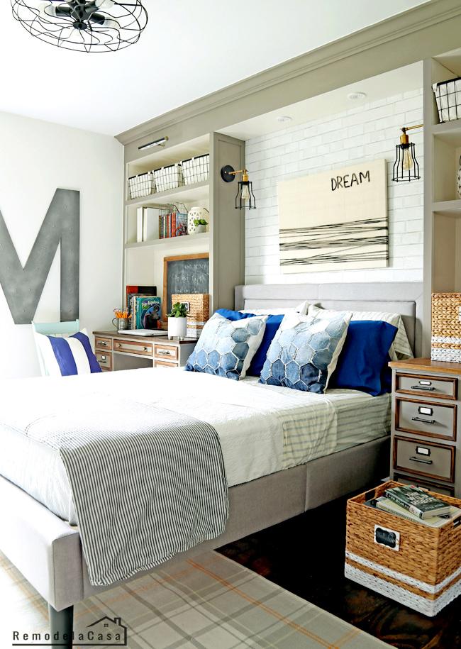 vintage industrial teen boy bedroom with build-ins around bed