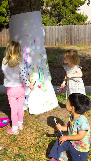 Tree Painting with Preschoolers and Toddlers- Such a fun outdoor art activity that young kids will love!