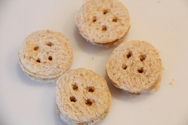 These peanut butter button sandwiches are cute and easy to make snack for kids.