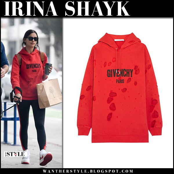 Irina Shayk in red hoodie givenchy, black leggings and white sneakers nike model street style october 29 2017