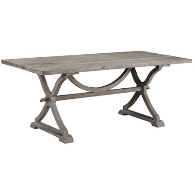 A rectangular French farmhouse style dining table, perfect for entertaining and family dinners. It's rustic, built to last, and still sleek enough to fit in with a shabby chic design.