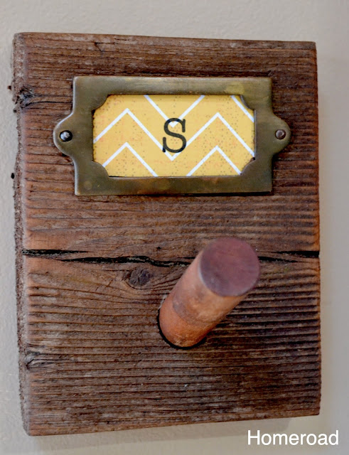 Brass accents on rustic peg hooks for the kitchen.
