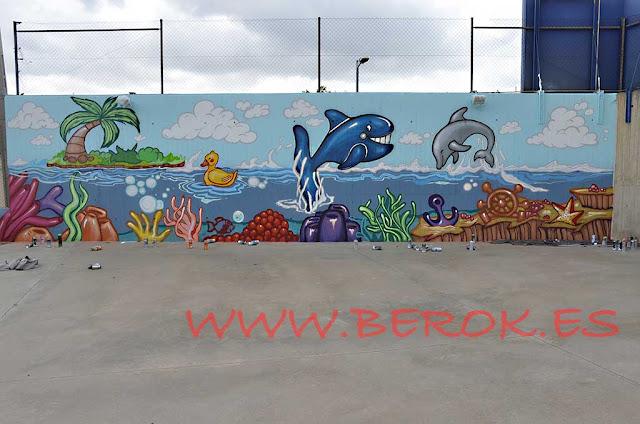 Pintura mural infantil de fondo marino en Escola Pia de Barcelona