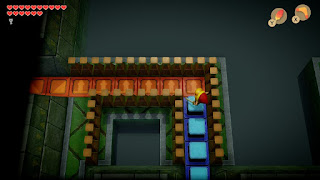 Link standing in one of the hollow rooms of the 3rd floor with crystal blocks in front of him