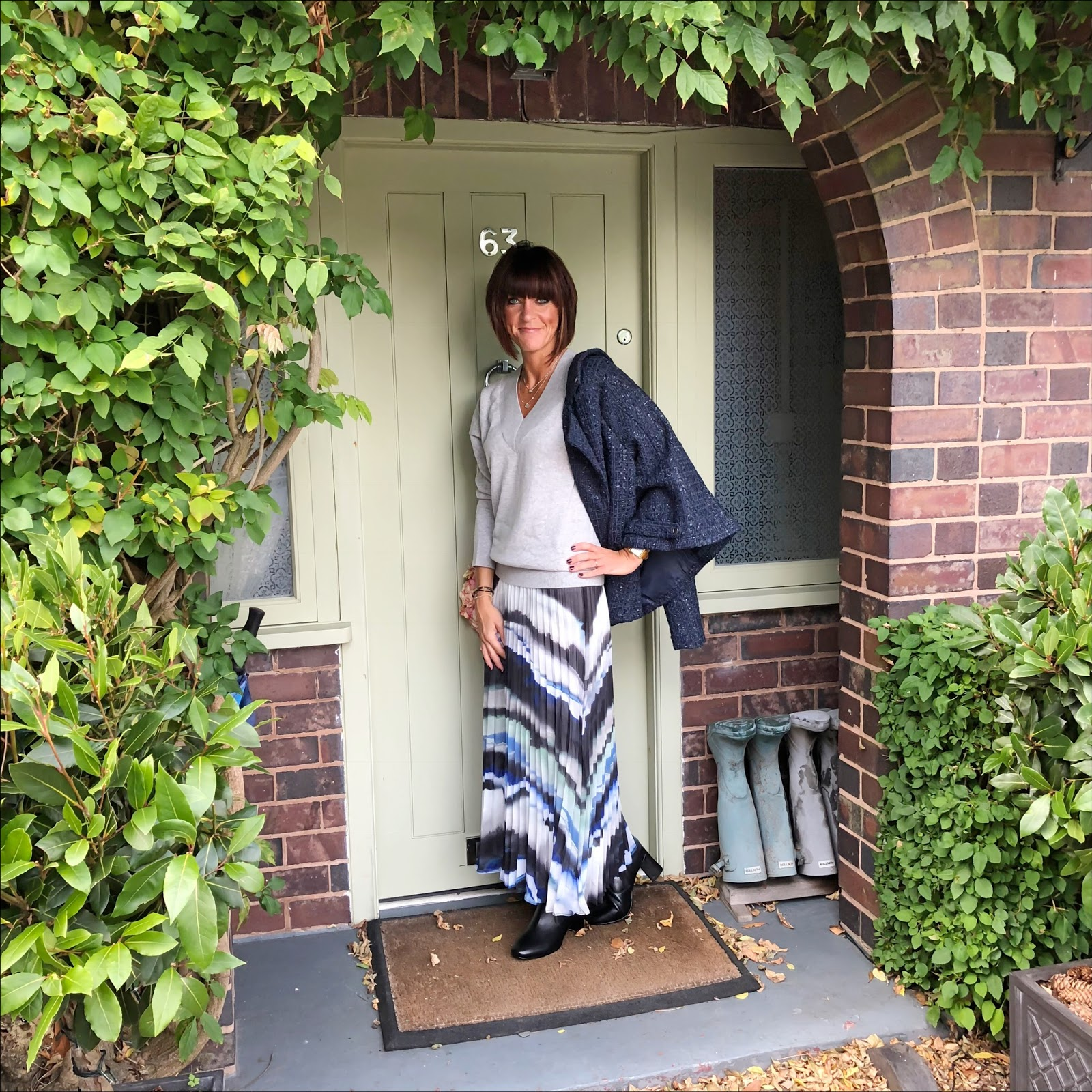 my midlife fashion, jd williams boucle biker jacket, concept cashmere v neck jumper, joanna hope print pleated maxi skirt, jd williams leather high leg boots