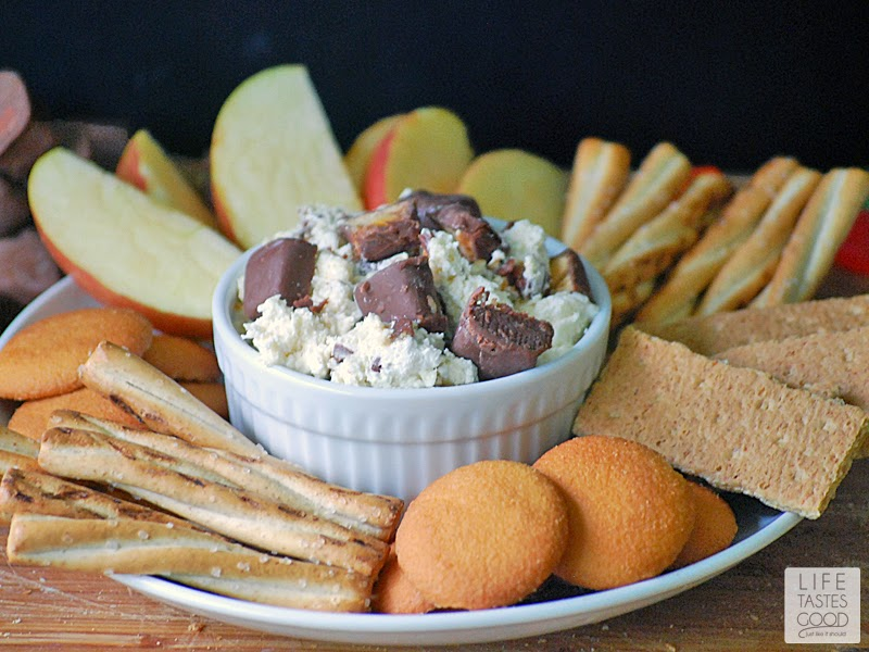 SNICKERS Dip | by Life Tastes Good is a sweet, creamy, dip perfect for the Big Game! This sweet cream cheese dip is loaded with SNICKERS Bites and a great dip for pretzels, apples, cookies, and graham crackers too! #BigGameTreats #ad