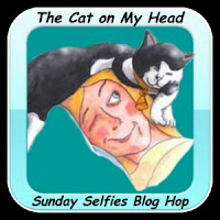 http://thecatonmyhead.com/blogpaws-conference-selfie/