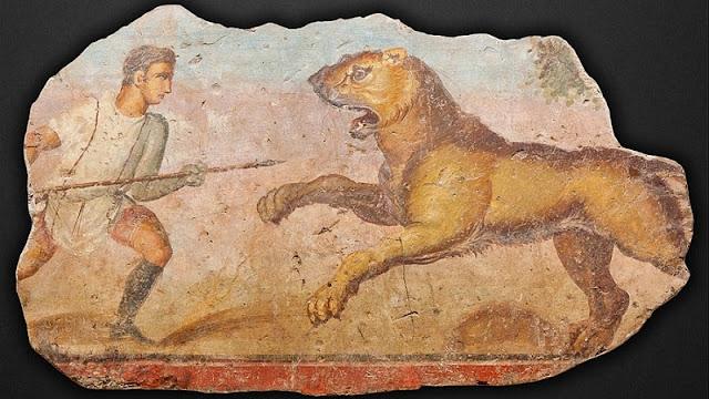 gladiator bestiarii sedang melawan singa menggunakan tombaknya