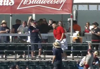 Indians fan makes one-handed grab with bare hand