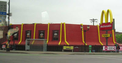 Red and yellow McDonald's roof, no building visible
