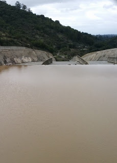 Top of the spillway with smooth water above, Lexington Reservoir, Los Gatos, California