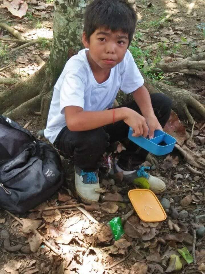 "Gitler Yanez hid among the trees to eat his ""baon"" of rice with ""toyo't suka"""