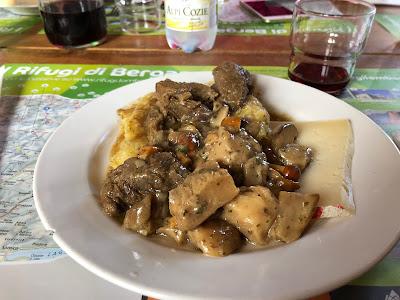 A main dish - piatto unico with polenta, spezzatino, funghi, fromaggio.