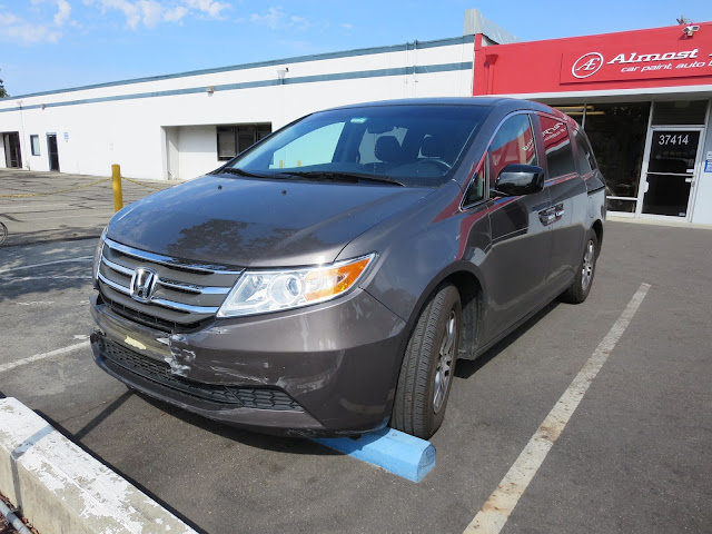 Honda Odyssey before collision damage repaired at Almost Everything Auto Body