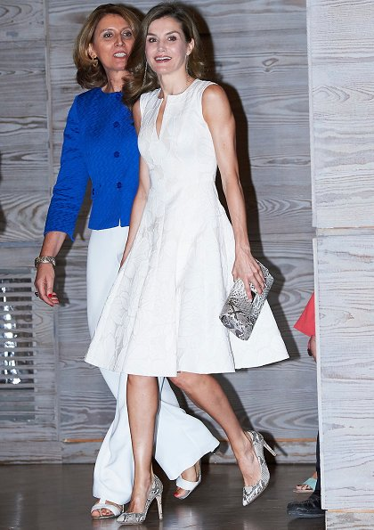 Queen Letizia wore Hugo Boss Regular dress in stretch virgin wool. Queen Magrit snake pumps at fashion ceremony