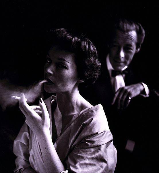 German actress Lilli Palmer (1914-1986), with husband Rex Harrison (1908-1990) in the background, photographed by Toni Frissell (1907-1988) in 1950