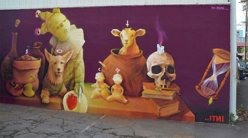 """After Venezuela a few weeks ago , INTI is now in Hawaii where he just finished working on this new street art mural dedicated to his recently deceased dog """"Peñi"""". 1"""