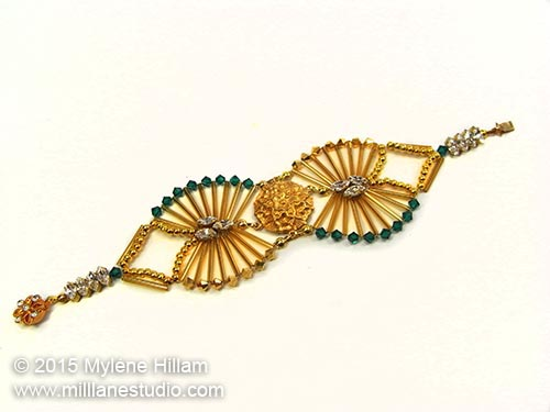 Art deco inspired bracelet featuring Emerald and Aurum Swarovski and long bugle beads
