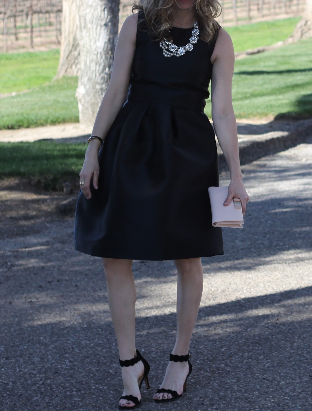 black satin midi skirt and top