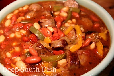 A quick skillet stew of sausage with peppers and onions, tomatoes, barbecue sauce, and beans.