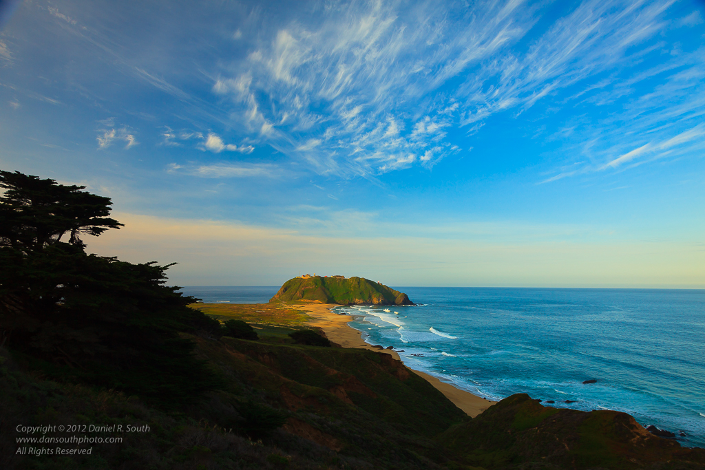 a photo of point sur under textured skies big sur california