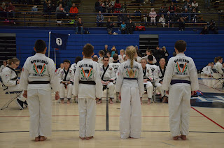 Martial arts kids getting ready for taewondo holiday camp