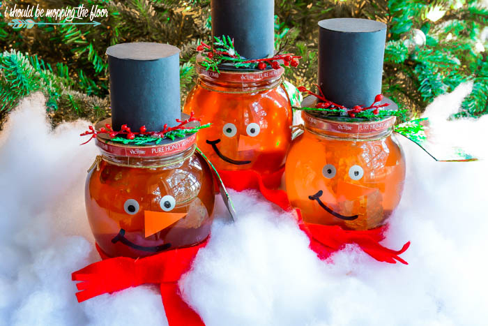 Snowman Honey Jars are a fun and easy holiday craft for all ages. Makes a cute teacher or neighbor gift.