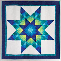 http://www.sliceofpiquilts.com/2018/11/glowing-lone-star-quilt.html