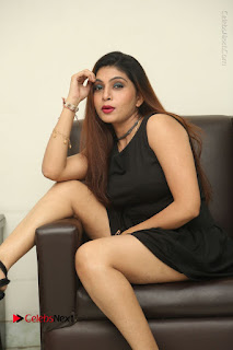 Tollywood Upcoming Actress Pooja Roshan Stills in Black Short Dress at Plus 1 Movie Trailer Launch  0261.JPG