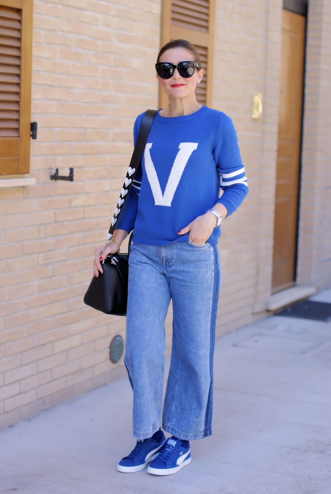 The initial letter sweater trend, varsity sweater royal blue outfit on Fashion and Cookies fashion blog, fashion blogger style