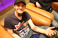 photo of tim cannon -founder of grid house wetware showing a chip under his skin on his left forearm.