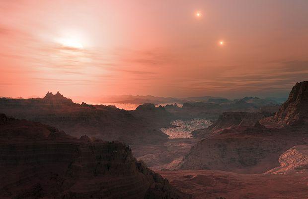 """Así es como posiblemente se vería un """"sunset"""" en el planeta KELT-4Ab. Un """"Sol"""" grande y dos pequeños en el cielo. La única diferencia, es que se trata de un gigante gaseoso."""
