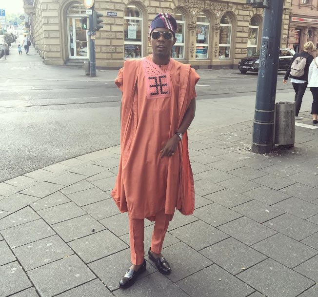 Dancehall singer Patoranking steps out in Germany rocking agbada