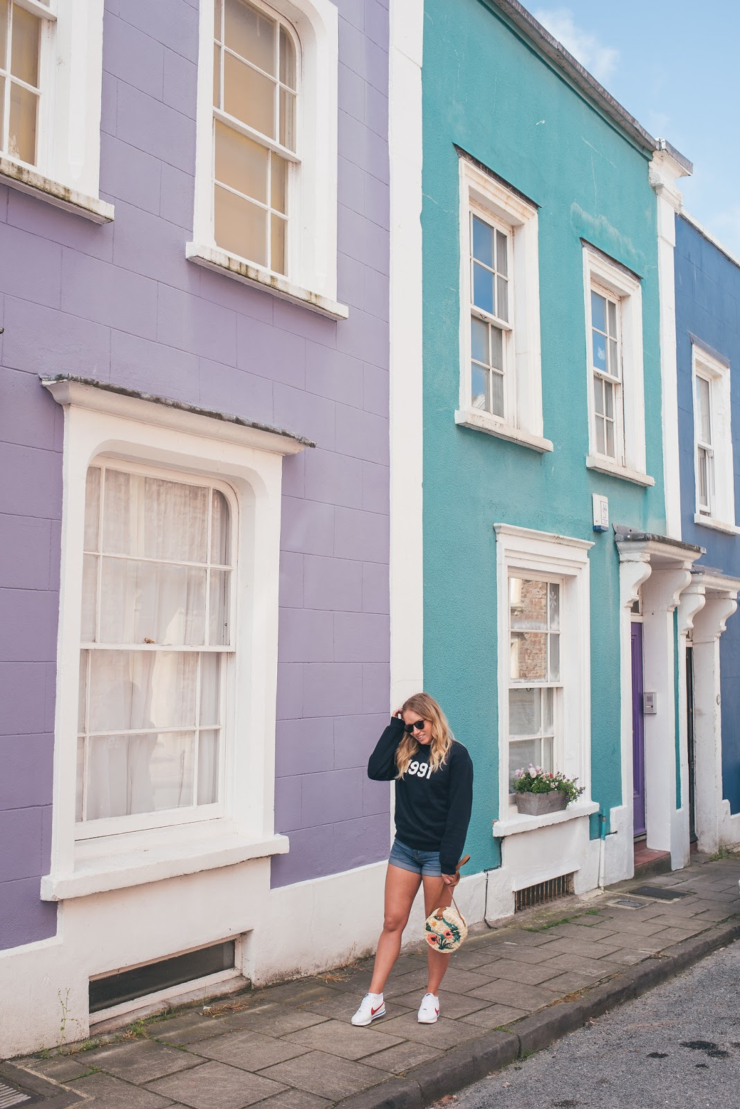 Rachel Emily Posing in front of Cliftonwood, Bristol Pastel coloured houses
