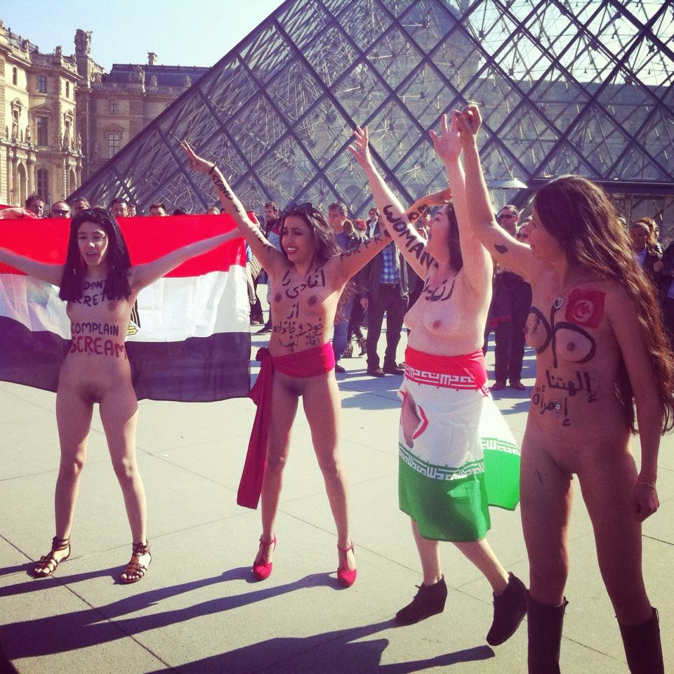 Arab, Iranian Women Protest Naked In Paris-7497