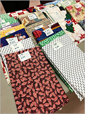February 7, 2019 At a quilter thrift sale, women downsizing their stashes.