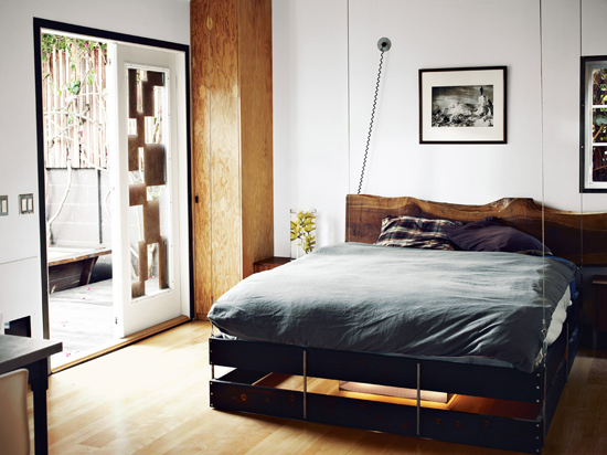 Wood slab headboard | Design by Funn Roberts, photo by Joe Pugliese.