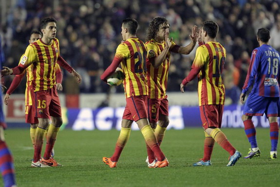 Barcelona players celebrate after they scored the equaliser against Levante