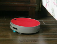 My bObi Pet robotic vacuum cleaner speeds off to clean under the bed.
