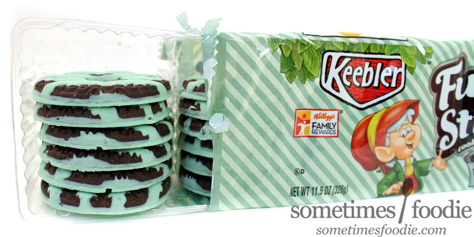 The Cookies Are Almost Brown Black Similar To Classic Oreos With Pale Mint Colored Confectionery Stripes And A