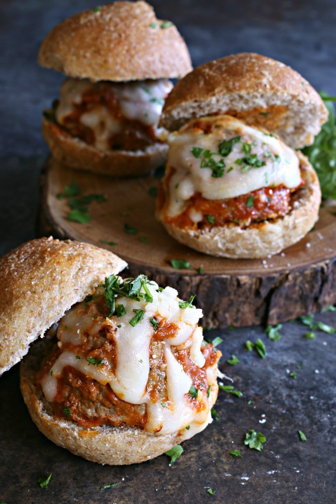 Beef and pork meatball sandwiches with tomato sauce and melted mozzarella cheese.